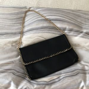 Faux leather black purse with gold color chain